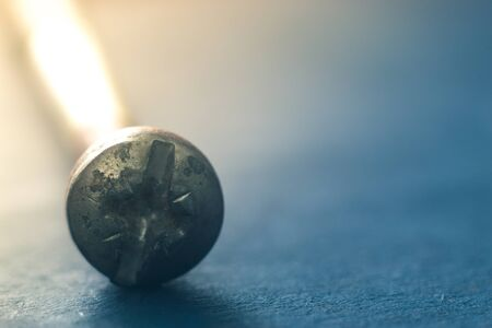 Cap bolt on a blue background close-up Stock Photo