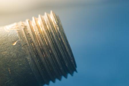 bolt carving close-up on a blue background 版權商用圖片