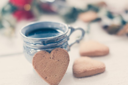 cup of coffee with cookies on a white background with ribbons.