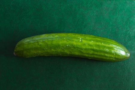 Fresh cucumber on a green board Stock Photo