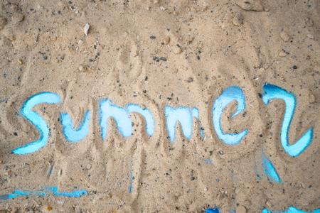 fading: Inscription summer on a sunny sandy beach Stock Photo