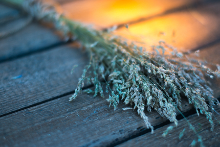 cultivate: Sheaf of hay on a wooden background