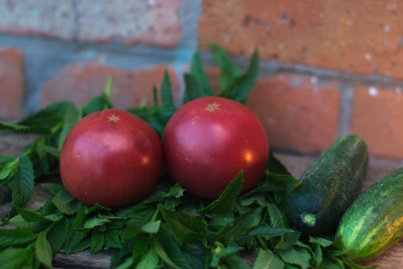 Ripe fresh tomatoes on a wooden background. Concept of healthy eating