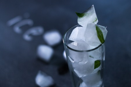 Natural ice in a glass on a black matte background