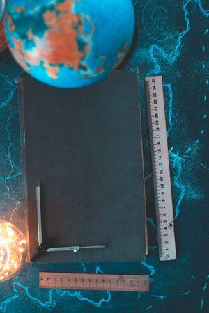 Still life globe on a black matte background with a barometer Imagens