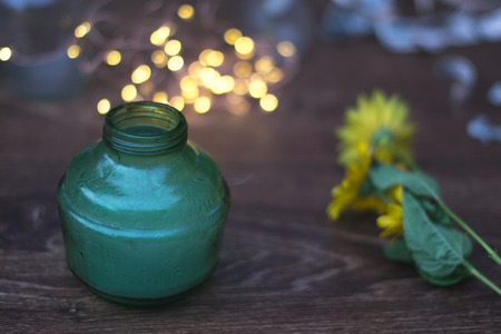 jag: Smoke in a glass green jar on a wooden background