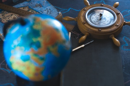 Still life globe on a black matte background with a barometer Banco de Imagens - 84570940