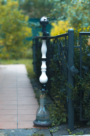 Hookah on a path to nature with a blurred background
