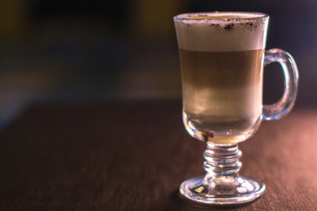 Coffee in a glass cup in a cafe with a blurred background Stock Photo