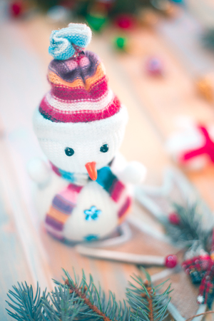 Snowman on a wooden background. New Year's still life