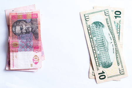 American dollars and Ukrainian hryvnia on a white background isolates.