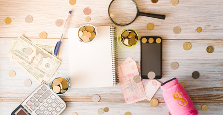 Business still life. Calculator, notepad bills on a wooden background, concept. Stock Photo