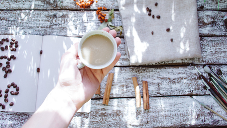 A cup in the hand still life. Morning Concept Stock Photo