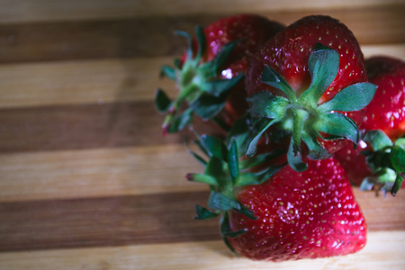 Fresh strawberries on a wooden background. Still life.
