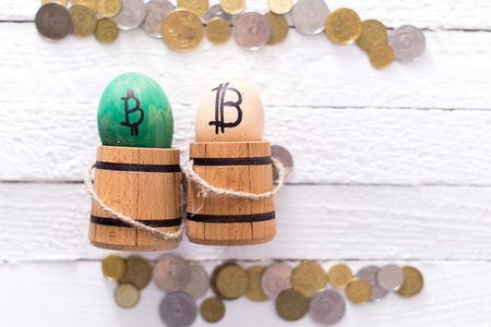 Egg with bitcoin in a wooden small barrel. Stock Photo
