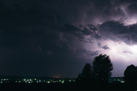 Night summer thunderstorm in the countryside. Night landscape.