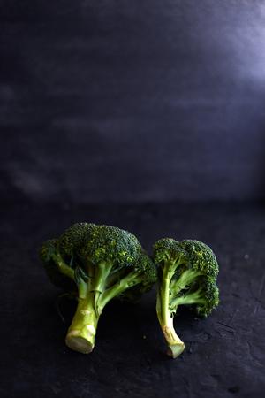 Fresh brocoli on a black matte background. Stock Photo