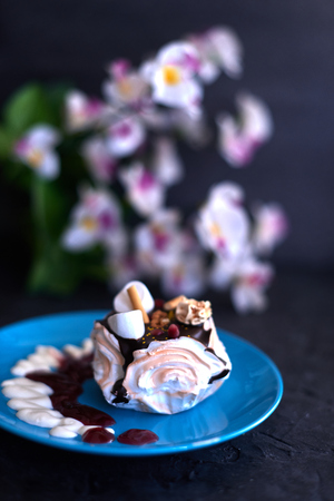 Cake on a blue plate on a black background. Stock Photo