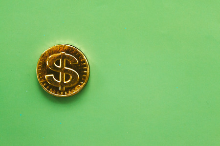 Coin dollar on a green background. Financial concept.