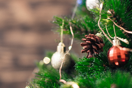 Christmas decorations on the tree with blurred background. Stock Photo