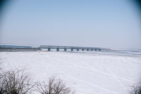 Bridge over the frozen river in Cherkassy. Stock Photo