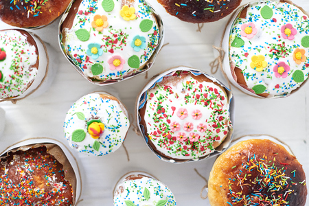 Easter cakes on a white wooden background.