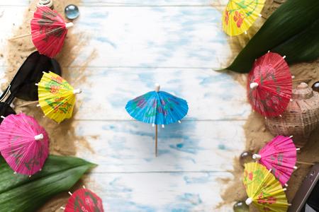 Summer concept. Beach umbrellas on a wooden blue background. Stock Photo