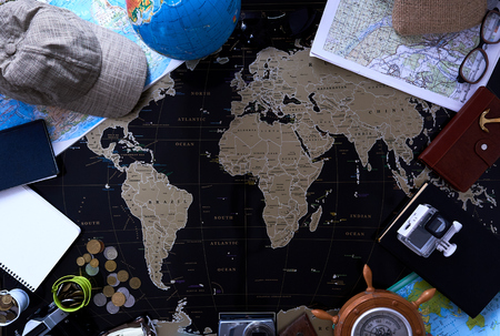 Black political map of the world. Still life of a traveler.