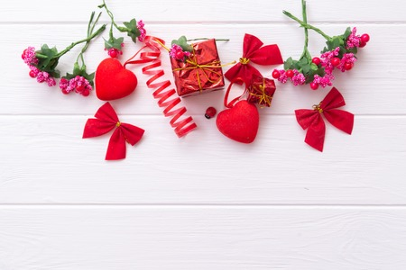 Conceptual still life for Valentines Day on a wooden white background with space for text. Stock Photo