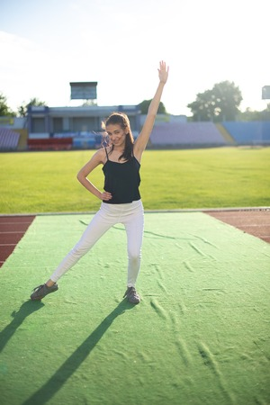 Young beautiful girl doing yoga outdoors in the park.