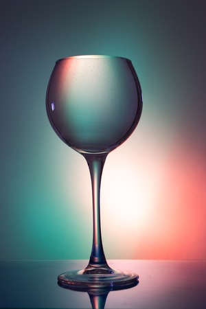 Glass of water on a colored background.