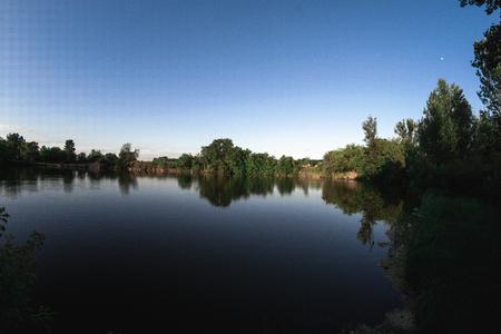 Evening summer landscape on the pond.