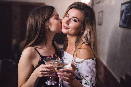 Girls at the bar with cocktails with a blurred background Stock Photo
