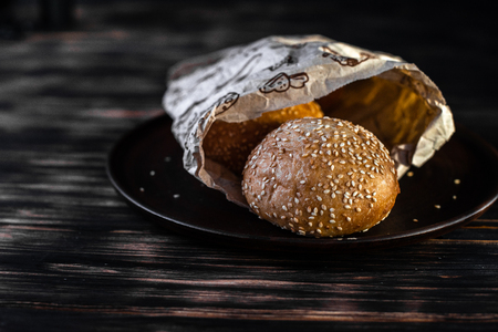Burger buns on a black background.