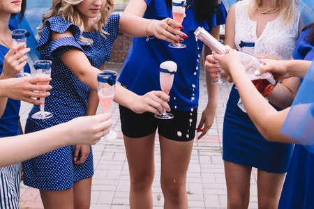 Bachelorette party, girls in blue dresses with glasses of champagne are having fun. Banco de Imagens