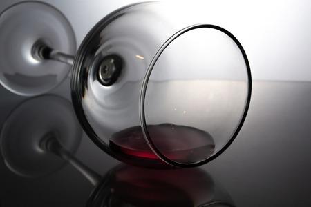 Wine glass on glossy gray background.