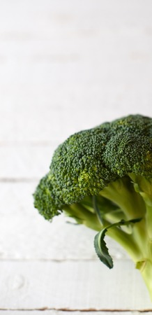 Fresh brocoli on a white wooden background.