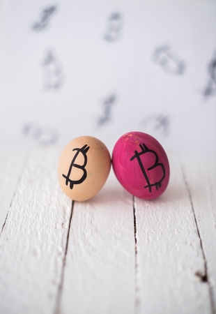 Bitcoin eggs on a wooden blurred background.
