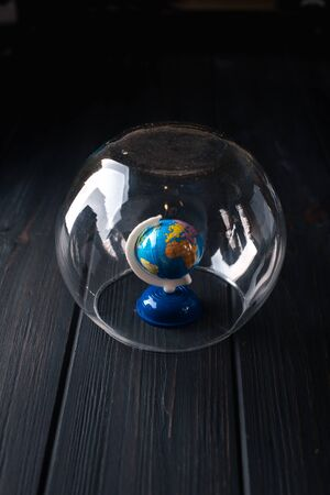 Earth under a glass bell. Quarantine, pandemic concept in the world COVID-19.