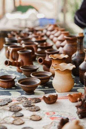 Handmade clay brown pots with blurry background.