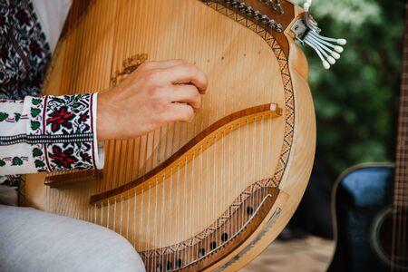 People with Ukrainian folk musical instruments at the festival. Reklamní fotografie