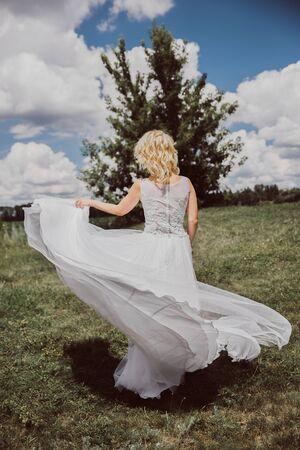 Girl bride wedding dress outdoors wedding summer photo shoot.