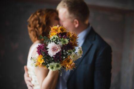 Newlyweds in a photo studio. Wedding Studio Photo Shoot. Archivio Fotografico - 148398782