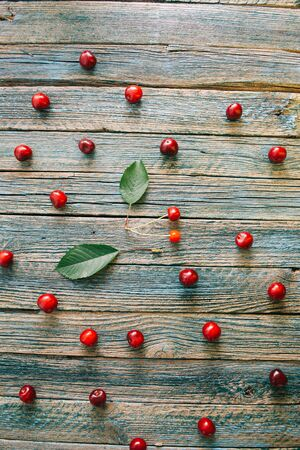 Fresh homemade ripe cherries on a wooden old background. Summer still life. Archivio Fotografico - 148489756