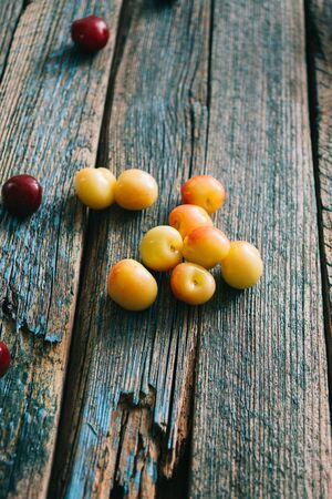 Fresh homemade ripe cherries on a wooden old background. Summer still life. Archivio Fotografico - 149044431