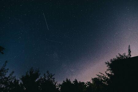 Night starry sky in the village in spring. Archivio Fotografico - 149592253