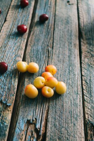 Fresh homemade ripe cherries on a wooden old background. Summer still life. Archivio Fotografico