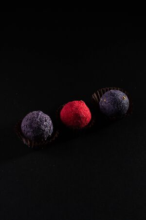 Colored round candies on a dark background.