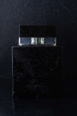 Black male cologne on a dark background.
