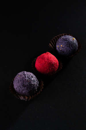 Colored round candies on a dark background.